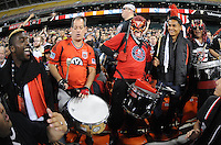 D.C. United defender Brandon McDonald (4) and midfielder Andy Najar (14) celebrating with fans during the game. D.C. United tied the Seattle Sounders, 0-0 at RFK Stadium, Saturday April 7, 2012.