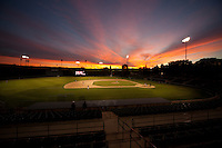 STANFORD, CA - February 4, 2011: The sun sets over a Stanford baseball scrimmage at Sunken Diamond on Stanford's campus.