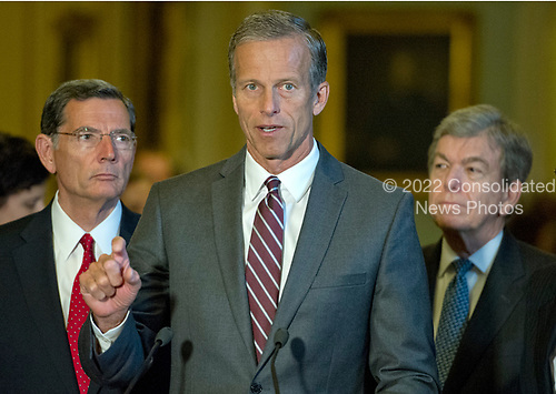United States Senator John Thune (Republican of South Dakota), center, speaks to reporters following the Republican Party luncheon in the United States Capitol in Washington, DC on Tuesday, July 11, 2017.  From left to right: US Senator John Barrasso (Republican of Wyoming), Senator Thune, and US Senator Roy Blunt (Republican of Missouri). <br /> Credit: Ron Sachs / CNP