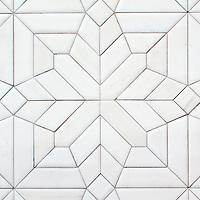Dominic, a hand-cut stone mosaic, shown in venetian honed Dolomite, is part of the Semplice™ collection for New Ravenna.