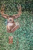 A proud mosaic deer adorns the shower wall in one of the en-suite bathrooms