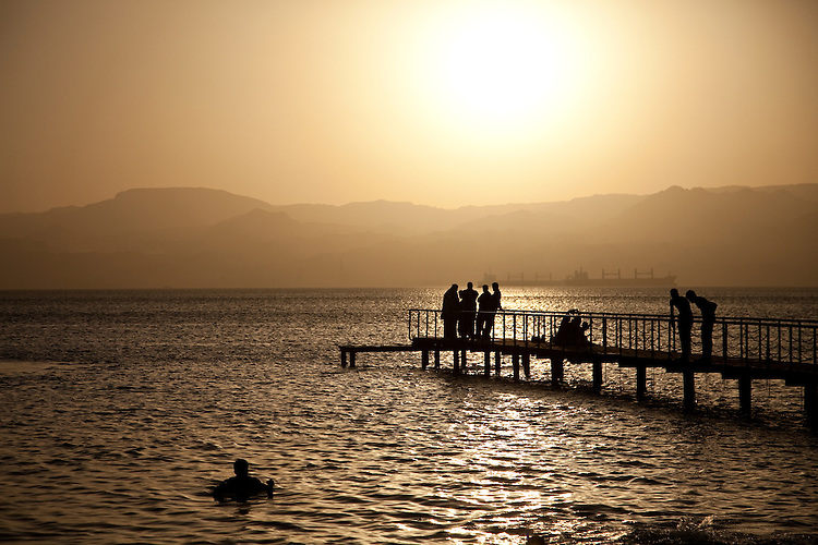 A golden sun drops into the Red Sea at Aqaba, Jordan