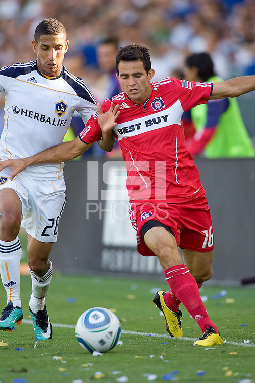 Marco Pappa of Chicago Fire attempts to move past Sean Franklin of the LA Galaxy. The Chicago Fire beat the LA Galaxy 3-2 at Home Depot Center stadium in Carson, California on Sunday August 1, 2010.