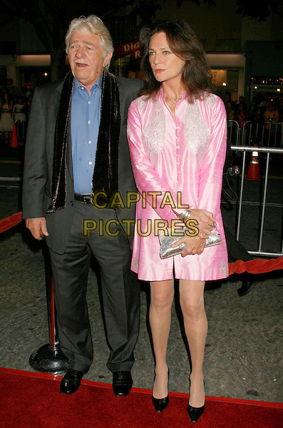 "JACQUELINE BISSET & GUEST.""Babel"" Special Presentation held at Mann Village Theater, Westwood, California, USA..November 5th, 2006.Ref: ADM/RE.full length pink coat jacket satin silver clutch purse grey gray suit.www.capitalpictures.com.sales@capitalpictures.com.©Russ Elliot/AdMedia/Capital Pictures. *** Local Caption *** ."