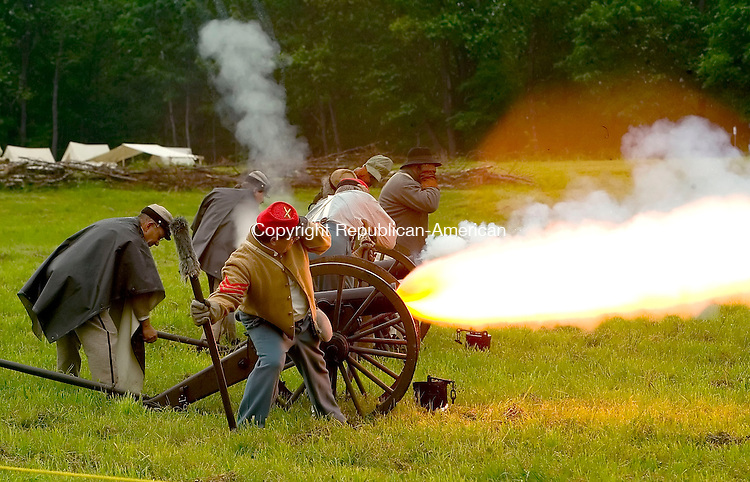 GOSHEN, CT--17 JUNE 2006 -061706JS01- Members of the 1st Co., Richmond Hositzers, fire a cannon during a demonstration Saturday at the Civil War encampment held at the Edmund D. Strang Scout Reservation in Goshen. The reenactment depicts the  Jackson Valley Campaign's  Battle at Wadhams Grove. The event continues today from 9-3. To view a milti-media slideshow of the event, visit http://media.rep-am.com/media/061706   -- Jim Shannon Republican-American