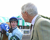 Jockey Oisin Murphy updates trainer of Belated Breath Hughie Morrison after winning The European Bloodstock News Ebf 'Lochsong' Fillies' Handicap during Racing at Salisbury Racecourse on 5th September 2019
