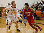 Reno's Karn Goraya is guarded by Galena's Josiah Wood in their Northern Region Division I boys basketball game played at Galena High School on Tuesday night, Feb. 17, 2015.