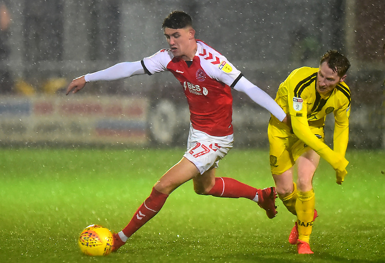 Fleetwood Town's Harrison Biggins vies for possession with Burton Albion\s Stephen Quinn<br /> <br /> Photographer Richard Martin-Roberts/CameraSport<br /> <br /> The EFL Sky Bet League One - Saturday 15th December 2018 - Fleetwood Town v Burton Albion - Highbury Stadium - Fleetwood<br /> <br /> World Copyright © 2018 CameraSport. All rights reserved. 43 Linden Ave. Countesthorpe. Leicester. England. LE8 5PG - Tel: +44 (0) 116 277 4147 - admin@camerasport.com - www.camerasport.com