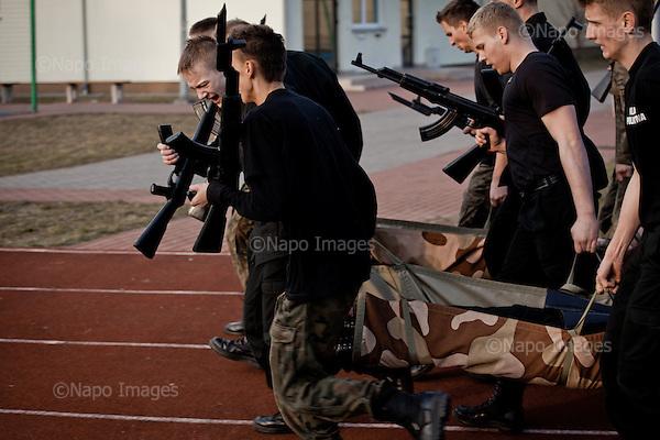 KALISZ, 7/03/2015:<br /> Cwiczenia z replikami broni na szkolnym boisku. W ten weekend czlonkowie organizacji zebrali sie w lokalnym liceum ogolnoksztalcacym na dwudniowe cwiczenia. Od rozpoczecia wojny na Ukrainie rozne organizacje paramilitarne staja sie coraz bardziej popularne.<br /> Fot: Piotr Malecki<br /> <br /> KALISZ, POLAND, MARCH 7, 2015:<br /> Young members of &quot;Strzelec&quot; (&quot;The Shooter&quot;) paramilitary association and of local classes with military profile, are having their training with dummy guns at the sports grounds of the local school.  (The guns are replicas of the real guns)  This weekend a few paramilitary groups from this region of Poland are having their trainining session, their base being a secondary school number 5 in Kalisz.<br /> Since the start of war in Ukraine, paramilitary associations are becoming more popular.<br /> (Photo by Piotr Malecki)