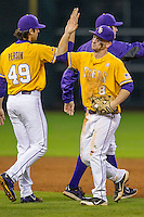 LSU Tigers shortstop Alex Bregman (8) celebrates with his teammates following the Houston College Classic against the Nebraska Cornhuskers on March 8, 2015 at Minute Maid Park in Houston, Texas. LSU defeated Nebraska 4-2. (Andrew Woolley/Four Seam Images)