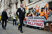 Construction company executives arrive at an awards event at the Royal Institute of British Architecture, London, as ancillary workers from the Great Western Hospital in Swindon, built and managed by Carillion, protest at bullying and blacklisting by the company.
