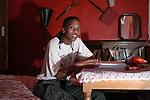 Neo  Kgengwe sits at her desk in the guest house where she stays when doing work experience at the mine. ..