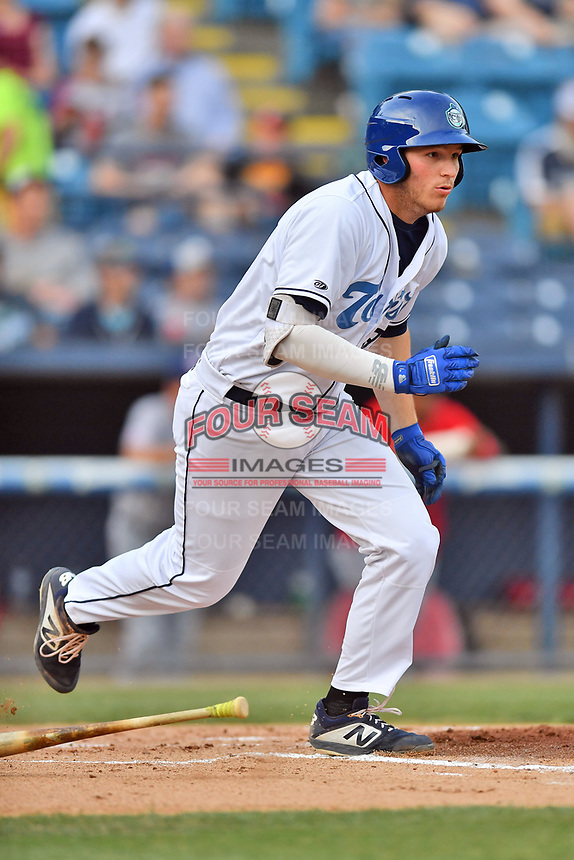 Asheville Tourists first baseman Grant Lavigne (34) runs to first base during a game against the Hagerstown Suns at McCormick Field on April 30, 2019 in Asheville, North Carolina. The Tourists defeated the Suns 5-4. (Tony Farlow/Four Seam Images)
