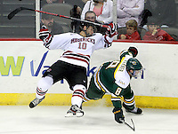 Nebraska-Omaha's Alex Simonson leaves the ice after colliding with Alaska-Anchorage's Scott Warner. (Photo by Michelle Bishop)