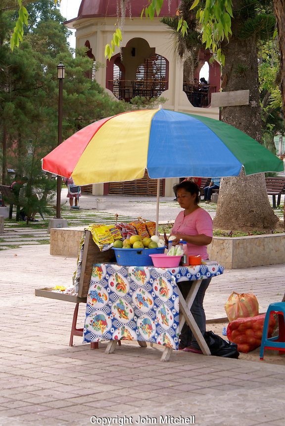 Woman selling fruit snacks the Spanish colonial town of Gracias, Lempira, Honduras...