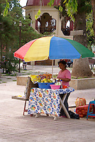 Woman selling fruit snacks the Spanish colonial town of Gracias, Lempira, Honduras...