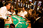 Blackjack table in Las Vegas, Nevada, Caesars Palace and Casino, gaming, gambling, chips, blackjack, betting croupier, blackjack players, model released, blackjack table, cards, NV, Las Vegas, Photo nv243-18332..Copyright: Lee Foster, www.fostertravel.com, 510-549-2202,lee@fostertravel.com