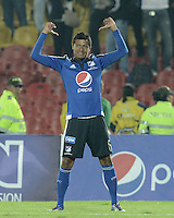 BOGOTA - COLOMBIA -25 -03-2015: Luis Mosquera de Millonarios celebra un gol anotado a Deportivo Pasto durante partido aplazado por la fecha 1 de la Liga Águila I 2015 jugado en el estadio Nemesio Camacho El Campín de la ciudad de Bogotá / Luis Mosquera (L) of Millonarios celebrates a goal scored to Deportivo Pasto during the postponed match for the first date of the Aguila League I 2015 played at Nemesio Camacho El Campin stadium in Bogotá city. Photo: VizzorImage / Gabriel Aponte / Staff.
