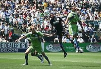 Ryan Johnson (19) heads the ball over Tyson Wahl (5) and Tyrone Marshall (right). The San Jose Earthquakes defeated Seattle Sounders FC 4-0 at Buck Shaw Stadium in Santa Clara, California on August 2, 2009.