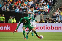 Seattle, WA - Tuesday June 14, 2016: Argentina midfielder Matias Kranevitter (5) and Bolivia forward Yasmani Duk (9) collide during a Copa America Centenario Group D match between Argentina (ARG) and Bolivia (BOL) at CenturyLink Field