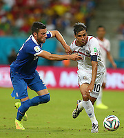 Vasileios Torosidis of Greece and Bryan Ruiz of Costa Rica in action