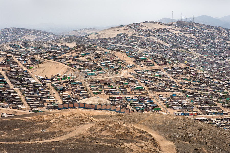 A sprawling settlement of houses and wooden shacks is seen on the dusty hillsides of Pachacútec, a desert suburb of Lima, Peru, 24 January 2015. Although Latin America (as a whole) is blessed with an abundance of fresh water, having 20% of global water resources in the the Amazon Basin and the highest annual rainfall of any region in the world, an estimated 50-70 million Latin Americans (one-tenth of the continent's population) lack access to safe water and 100 million people have no access to any safe sanitation. Complicated geographical conditions (mainly on the Pacific coast), unregulated industrialization (causing environmental pollution) and massive urban poverty, combined with deep social inequality, have caused a severe water supply shortage in many Latin American regions.