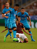 Barcellona's Neymar is challenged by  AS Roma's Iago Falque    during the Champions League Group E soccer match   at the Olympic Stadium in Rome September 16, 2015