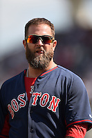 Boston Red Sox first baseman Mike Napoli (12) during a spring training game against the Tampa Bay Rays on March 25, 2014 at Charlotte Sports Park in Port Charlotte, Florida.  Boston defeated Tampa Bay 4-2.  (Mike Janes/Four Seam Images)