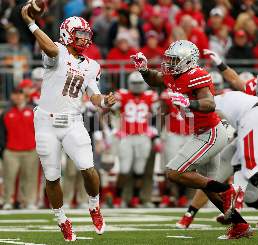 Rutgers Scarlet Knights quarterback Gary Nova (10)  is pressured by Ohio State Buckeyes linebacker Joshua Perry (37) during Saturday's NCAA Division I football game at Ohio Stadium in Columbus. The Buckeyes led at halftime 35-7. (Dispatch Photo by Barbara J. Perenic)