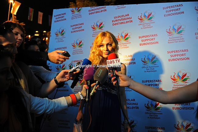 Nigar Jamal of Ell and Nikki, winner of the Eurovision Song Contest in 2011 which earned Baku the right to host this year's contest, speaks to the media before performing at the Eurovision Fan Club concert on the Bulvar seaside promenade in Baku, Azerbaijan on April 29, 2012.