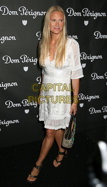 KELLY LYNCH.Dom Perignon Unveils the New Image of Dom Perignon Rose Vintage 1996 by Karl Lagerfeld, Beverly Hills, California, USA, June 2 2006..full length white dress.Ref: ADM/BP.www.capitalpictures.com.sales@capitalpictures.com.©Byron Purvis/AdMedia/Capital Pictures.