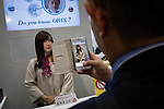 A visitor takes a pictures with his smartphone of an android Madoka MirAI manufactured by A-Lab displayed by Japanese rental firm ORIX Rentech at an robot exhibition Robodex in Tokyo on January 17, 2019. Some 220 robot companies display their recent products and technlogies at a three-day exhibition. January 17, 2019 (Photo by Nicolas Datiche/AFLO) (JAPAN)