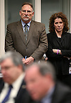Gov. Brian Sandoval's Chief of Staff Mike Willden and General Counsel Michon Martin listen as Treasurer Dan Schwartz presents and alternative budge proposal to the Senate Finance Committee at the Legislative Building in Carson City, Nev., on Thursday, Feb. 12, 2015. <br /> Photo by Cathleen Allison