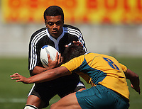 Jarrod Butler tries to tackle Joseph Tupe during the International rugby match between New Zealand Secondary Schools and Suncorp Australia Secondary Schools at Yarrows Stadium, New Plymouth, New Zealand on Friday, 10 October 2008. Photo: Dave Lintott / lintottphoto.co.nz