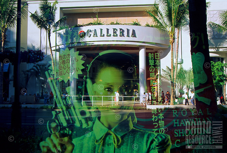 Waikiki Galleria with poster of an asian women with a gun superimposed