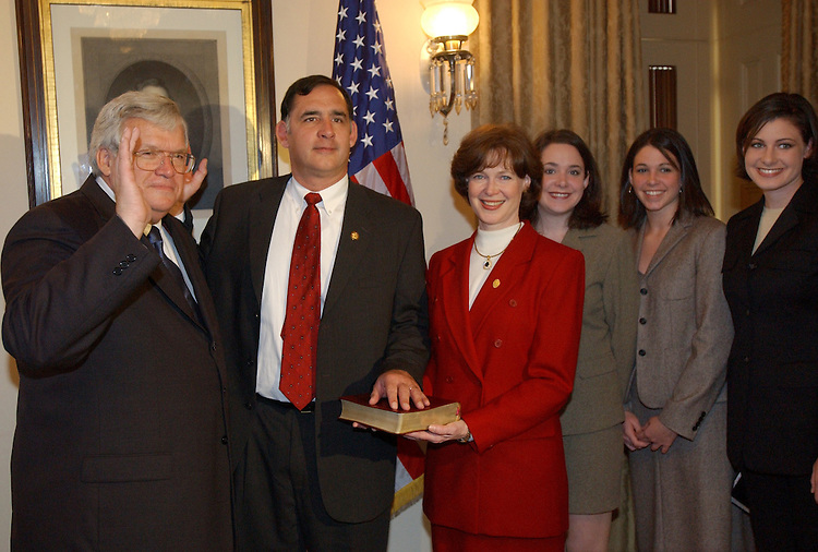2Boozman112801 -  Newly sworn in Rep. John Boozman, R-Ark., center, poses for a photo with, from left, Speaker Dennis Hastert, R-Ill., Boozman, wife Cathy, and daughters Shannon, Lauren, and Kristen.