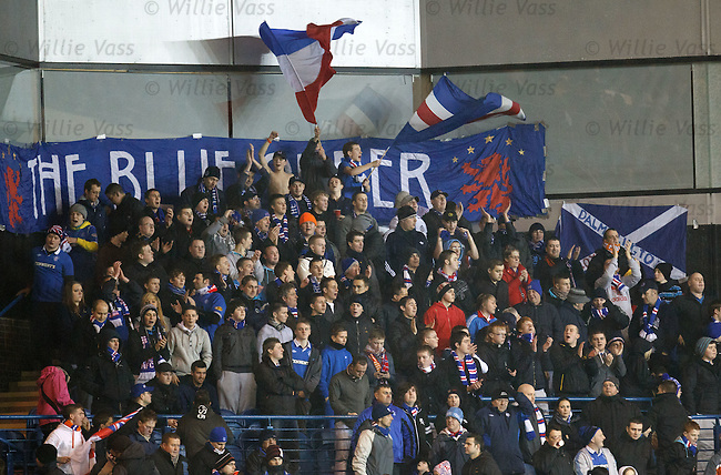 Rangers fans try to get some atmosphere going in a less than packed stadium