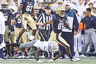 Annapolis, MD - September 8, 2018: Navy Midshipmen wide receiver Collins Woods III (81) gets tackled by a Memphis Tigers defender during the game between Memphis and Navy at  Navy-Marine Corps Memorial Stadium in Annapolis, MD.   (Photo by Elliott Brown/Media Images International)