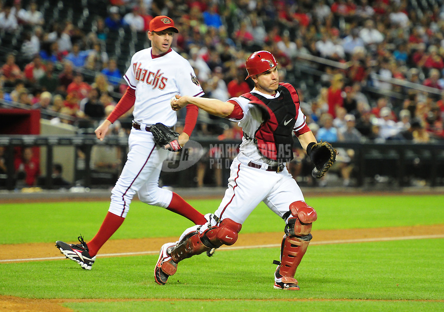 May 8, 2012; Phoenix, AZ, USA; Arizona Diamondbacks catcher Miguel Montero throws to first base for an out in the eighth inning against the St. Louis Cardinals at Chase Field. Mandatory Credit: Mark J. Rebilas-