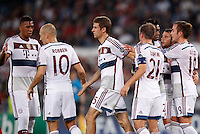 Calcio, Champions League, Gruppo E: Roma vs Bayern Monaco. Roma, stadio Olimpico, 21 ottobre 2014.<br /> Bayern's Thomas Mueller, third from right, celebrates after scoring on a penalty kick during the Group E Champions League football match between AS Roma and Bayern at Rome's Olympic stadium, 21 October 2014.<br /> UPDATE IMAGES PRESS/Isabella Bonotto