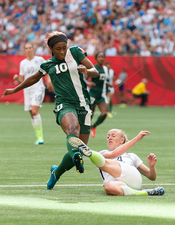 June 16, 2015: Becky SAUERBRUNN of the USA kicks the ball during a Group D match at the FIFA Women's World Cup Canada 2015 between Nigeria and the USA at BC Place Stadium on 16 June 2015 in Vancouver, Canada. USA won 1-0. Sydney Low/Asteriskimages.com