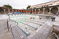 Crews work on Taylor Pool by resurfacing the shallow end and giving the rest an acid bath, Dec. 19, 2014. (Photo by Marc Campos, Occidental College Photographer)