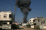 Smoke is seen following what police said was an Israeli air strike in Rafah in the southern Gaza Strip July 9, 2014. Militants in Gaza fired more rockets at Tel Aviv on Wednesday, targeting Israel's heartland after Israeli attacks in the enclave that Palestinian officials said have killed at least 28 people. Israel assassinated a senior local leader of the Islamic Jihad militant group in the northern Gaza Strip early on Wednesday, neighbours and hospital officials said, and five others including family members were killed. An Israeli military spokeswoman said she had no initial details on the strike.The militant, Hafez Hamad, two brothers and his parents were killed when his house was bombed in an air strike in the town of Beit Hanoun in the northern Gaza Strip, Hamas media and Gaza interior ministry said. An unidentified woman in the house was also killed. Photo by Eyad Al Baba