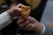 Representative Steve Cohen, Democrat of Tennessee, hands Rep. Katie Hill, Democrat of California, a piece of chicken from a bucket of Kentucky Fried Chicken he brought with him prior to a hearing scheduled for Attorney General William Barr to testify about the Mueller Report before the United States House or Representatives Judiciary Committee on Capitol Hill in Washington, D.C. on May 2, 2019. Credit: Alex Edelman / CNP