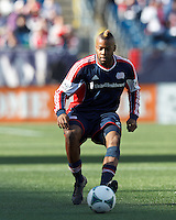New England Revolution defender Andrew Farrell (2) passes the ball. .  In a Major League Soccer (MLS) match, FC Dallas (red) defeated the New England Revolution (blue), 1-0, at Gillette Stadium on March 30, 2013.
