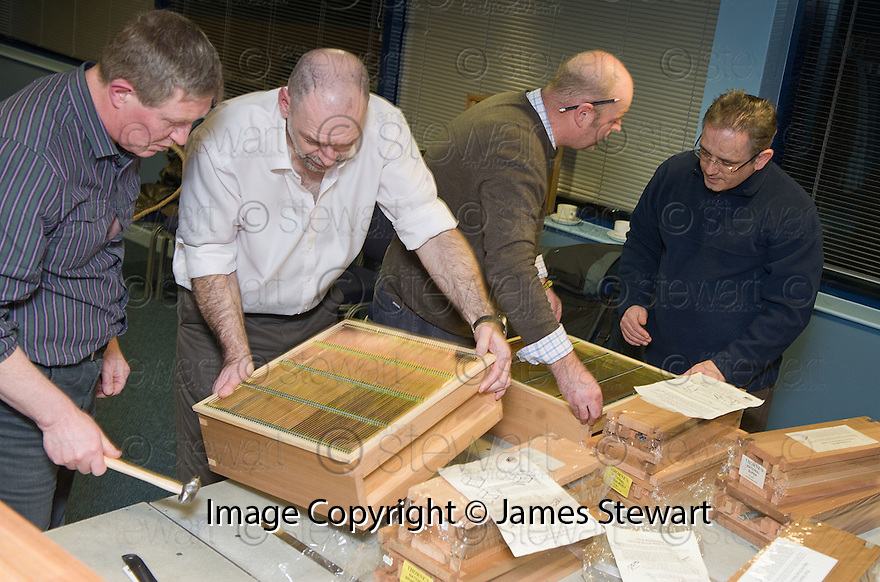 The Helix bee keepers build their hives at the Helix Bee Keeping Workshop. .