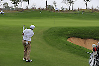 Felipe Aguilar (CHI) chips onto the 5th green during Saturay's Round 3 of the 2014 BMW Masters held at Lake Malaren, Shanghai, China. 1st November 2014.<br /> Picture: Eoin Clarke www.golffile.ie