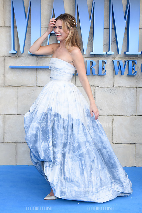 "Lily James arriving for the ""Mama Mia! Here We Go Again"" world premiere at the Eventim Apollo, Hammersmith, London, UK. <br /> 16 July  2018<br /> Picture: Steve Vas/Featureflash/SilverHub 0208 004 5359 sales@silverhubmedia.com"