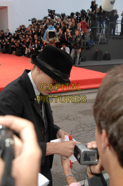 "HEATH LEDGER.""I'm Not There"" premiere screening .64th Venice Film Festival.4th September 2007, Italy.La Biennale di Venezia, half length trilby hat meeting fans signing autographs.Ref: CAP/PL.©Phil Loftus/Capital Pictures"