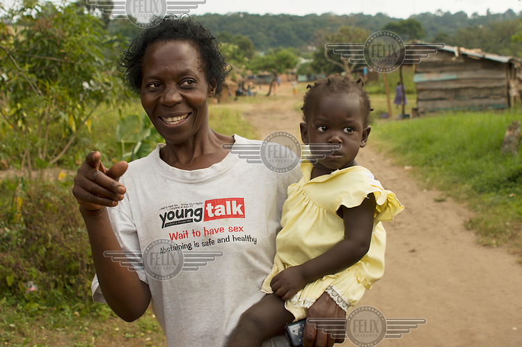 A woman wears a t-shirt advocating abstainance in Louloboka Village, Lake Victoria...